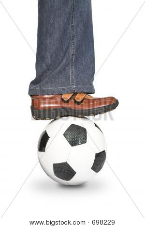 Leg Stepping Onto A Football