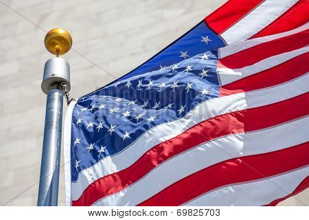 American Flag Waving In The Wind With Flag Pole