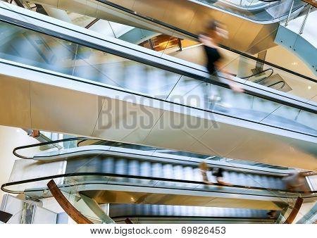 People In Motion In Escalators