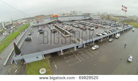 MOSCOW, RUSSIA - NOVEMBER 24, 2013: Shopping Center Mall Gallery and Auchan hypermarket with a large parking area. Shopping Center opened July 28, 2005