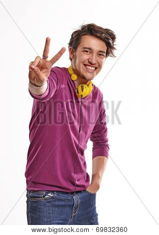 Young expressive and happy guy wearing yellow headphones.Happy deejay.