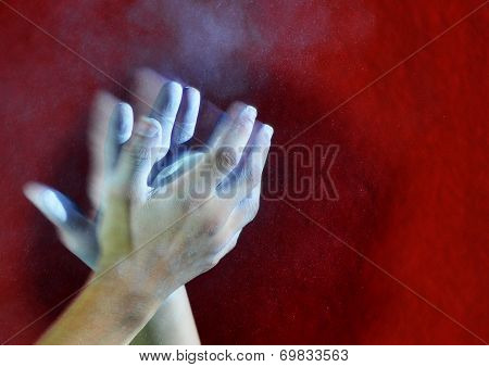 hands with a ball of powder chalk magnesia