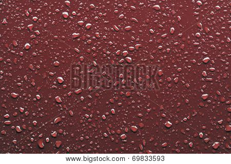 Raindrops On Red Background