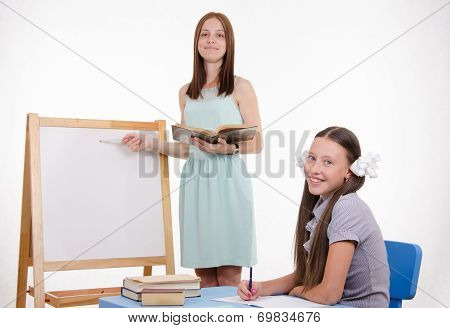 Teacher Explains Topic Of Lesson At Blackboard