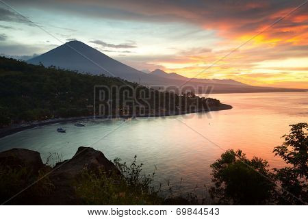 Sunset over calm lagoon in tropics