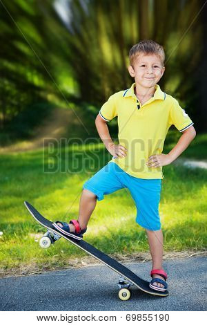 Little boy enjoying skateboarding in the park.