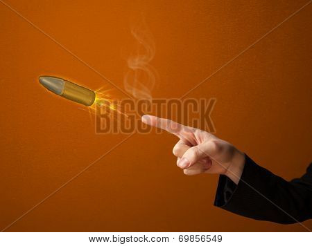 Gun shaped male hand with bullet coming out of it