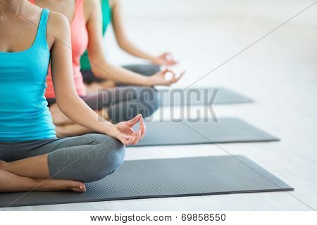 Young girls do yoga indoors