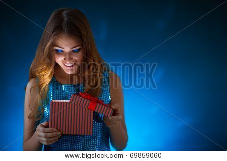 Young attractive girl with a gift