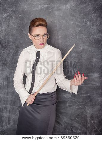 Strict Teacher With Wooden Pointer