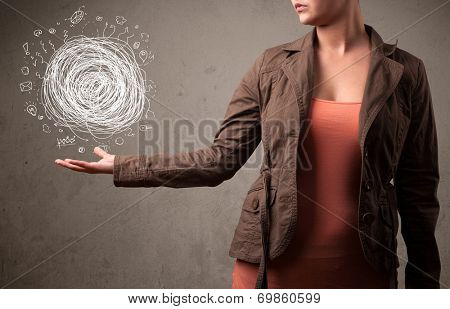Young woman holding chaos concept in her hand