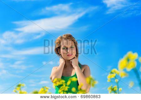 blond woman in a rape field
