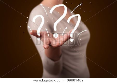 Young beautiful woman presenting hand drawn question marks