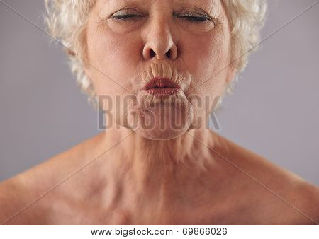 Senior Woman Puckering Lips