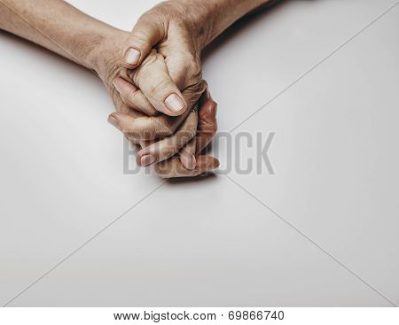 Senior Woman's Hands On Grey Background