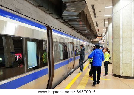 BEIJING, CHINA - APR 7: Beijing subway interior on April 7, 2013 in Beijing, China. Beijing subway system is the oldest in mainland China operated since 1969.