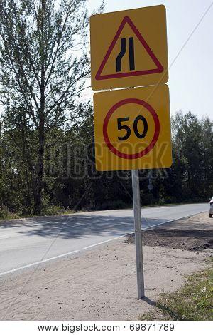Regulatory-signs On A Road Under Blue Sky