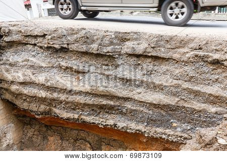Close Up Soil Layers Under Asphalt Road Dug By A Backhoe