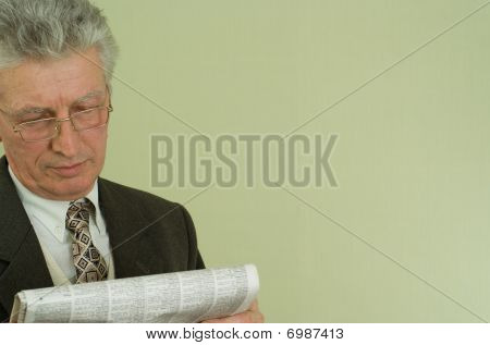 Handsome Businessman Read The Newspaper