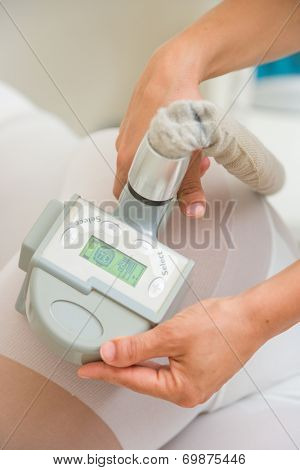 Therapist applying lipo massage LPG treatment - selective focus narrow DOF