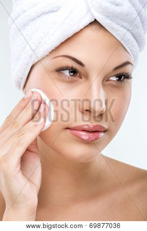 Beautiful woman with flawless skin cleansing