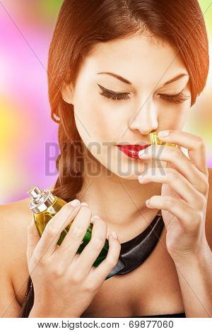 Beautiful attractive woman with luxury make-up perfume smell eyes closed