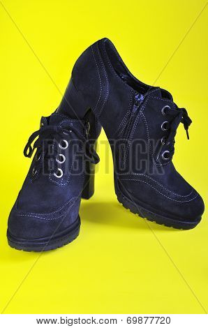 Women's Ankle Boots In Black Suede On A Yellow Background