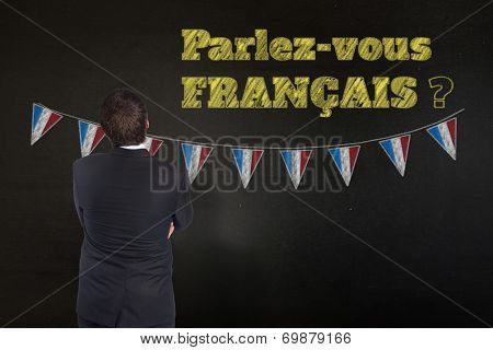 Thinking businessman against black, Do you speak French?