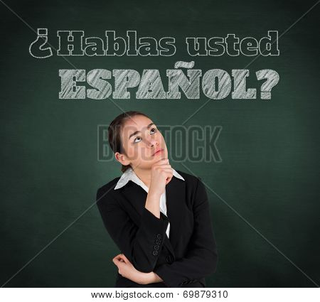Composite image of businesswoman thinking against green chalkboard, Do you speak Spanish?