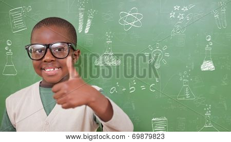Cute pupil showing thumbs up against school doodles