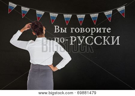 Composite image of businesswoman scratching her head against black, Do you speak Russian?