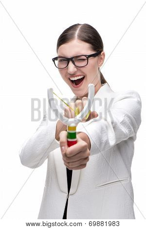 Smiling young woman with glasses holding slingshot