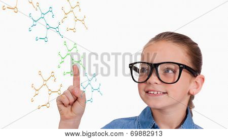 Cute pupil pointing against rocket science theory