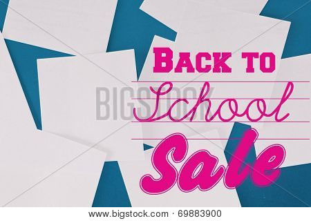 Back to school sale message against white paper strewn over blue