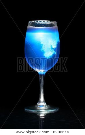 Isolated Glass With Blue Splashing Beverage