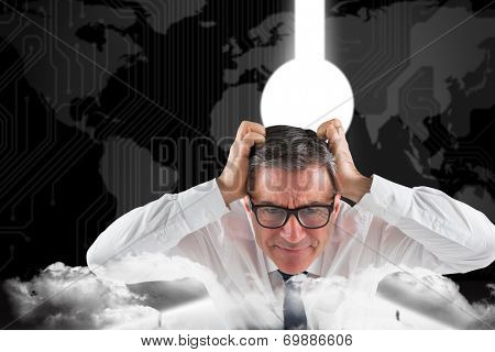 Stressed businessman touching his head against business people going through keyhole door