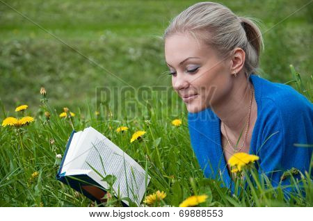 A Girl Student With A Book In The Park
