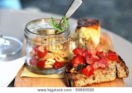 Italian Food With Pasta; Pieces Of Pizza And Bruschetta