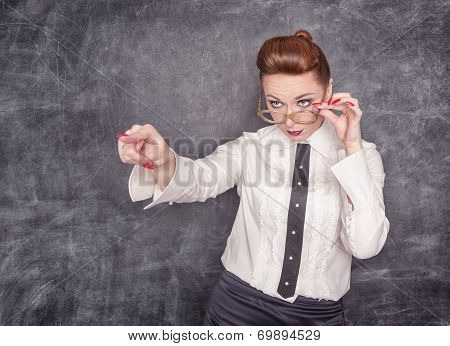 Strict Teacher Showing On Someone By Finger