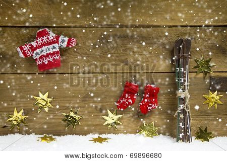 Wintry Christmas Decoration With Ski And Winter Clothes On Wooden Background.