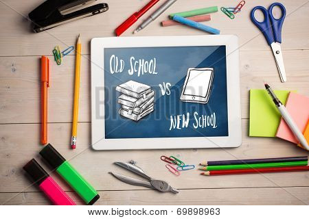Composite image of digital tablet on students desk showing doodles