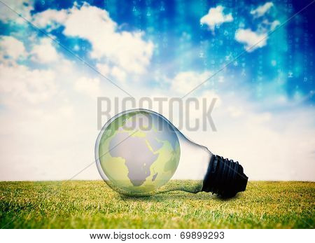 Lines of blue blurred letters falling against earth inside light bulb