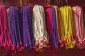 image of cultural artifacts  - colorful buddhists beads rosary near temple in asia Kathmandu Nepal - JPG