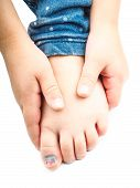 image of big-foot  - Girl holding onto her foot with a blue nail on the big toe after injury - JPG