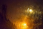 image of diffusion  - Rain on a glass window at night during a storm - JPG