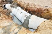 foto of sewage  - Close up sewer system installation in city - JPG