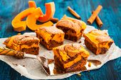 stock photo of brownie  - Pumpkin swirl brownies on blue wooden background - JPG