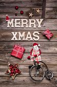 pic of unicycle  - Nostalgic country style decoration with text red and wood for a christmas greeting card - JPG
