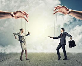 image of male-domination  - image of a two puppet businessman standing on against each other - JPG