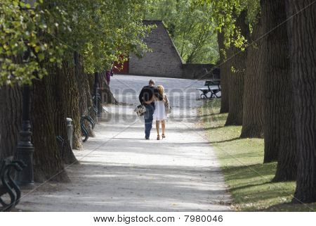 Lovers walking together in an alley